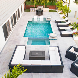 Custom Pool & Spa With Water and Fire Bowls in Pompano Beach