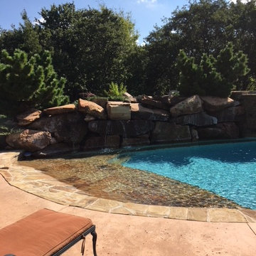 Custom Pool with Beach Entry and Large Waterfall