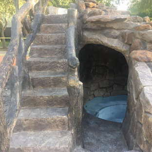 Inspiration for a mid-sized country backyard custom-shaped natural pool in Orange County with a water slide.