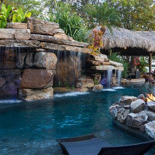 Custom Rock Waterfall Pool with Stone Grotto, Stream and Tiki Hut