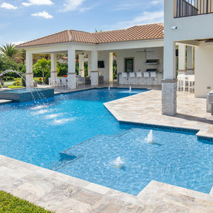 Custom Shaped Pool With Spa, Laminar Deck Jets and Custom Fountain in Parkland