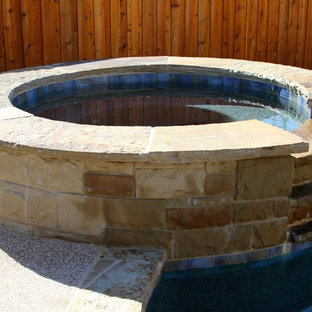 Custom Stone Hot Tub with Waterfall Feature