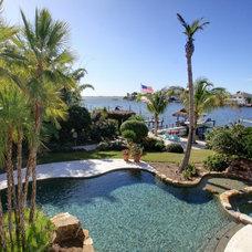 Beach Style Pool by Brandon Construction Company