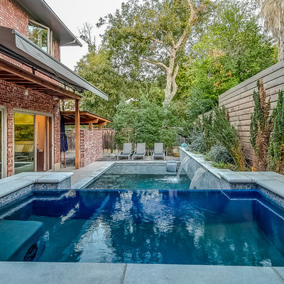 Hot tub - mid-sized transitional backyard rectangular and concrete infinity hot tub idea in Dallas