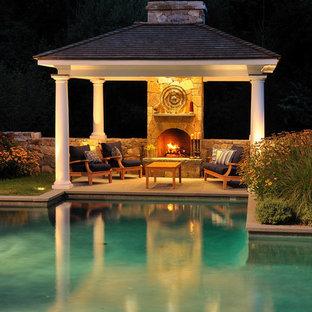 Elegant custom-shaped pool house photo in New York