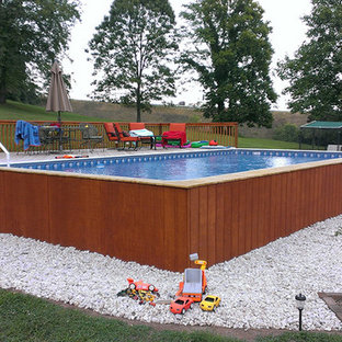 Inspiration for a mid-sized modern backyard rectangular aboveground pool remodel in Detroit with decking