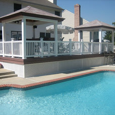 Traditional Pool by American Deck and Patio