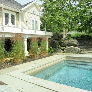 Hot tub - small rustic front yard stone and rectangular hot tub idea in Burlington
