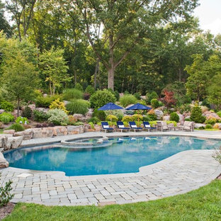 Example of a classic custom-shaped pool design in New York