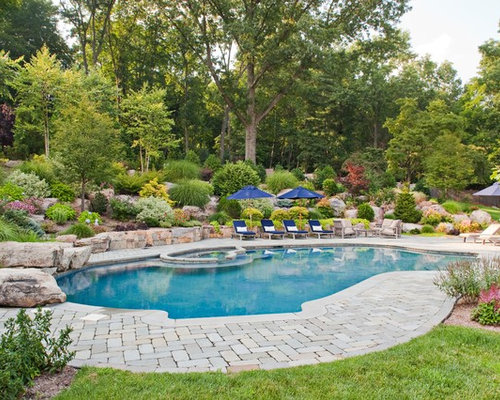 Pool Paver Ideas kidney shaped pool Example Of A Classic Custom Shaped Pool Design In New York With Brick Pavers