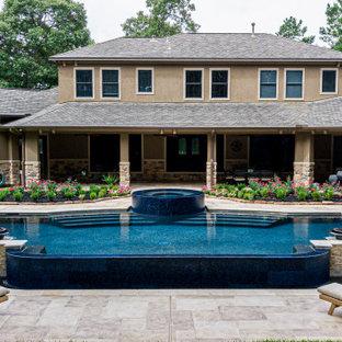 Foto di un'ampia piscina minimal personalizzata dietro casa con pedane