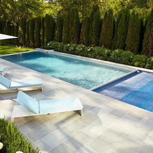 Modelo de piscina con fuente infinita, clásica renovada, grande, rectangular, en patio trasero, con adoquines de piedra natural