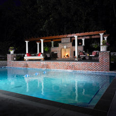 Contemporary Pool by David J Frank Landscape Contracting Inc