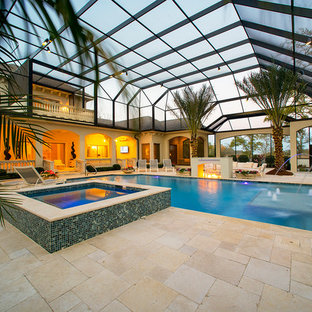 Pool house - mediterranean indoor rectangular pool house idea in Other