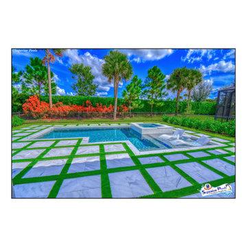 (Dunn) NAPLES, FL Superior Pools Custom Turf & Travertine Deck Pool & Spa.