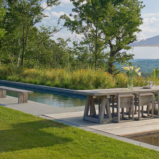 Pool - cottage backyard pool idea in New York with decking