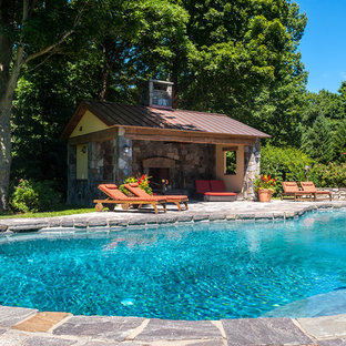 Pool - large traditional backyard stone and custom-shaped pool idea in New York