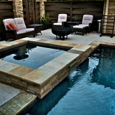 Asian Pool by CAVINESS LANDSCAPE DESIGN, INC.