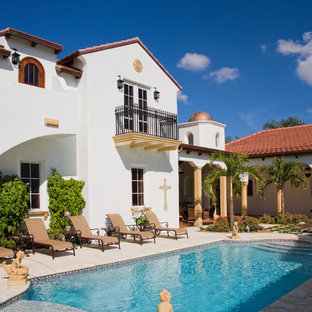 Example of a tuscan courtyard pool design in Miami