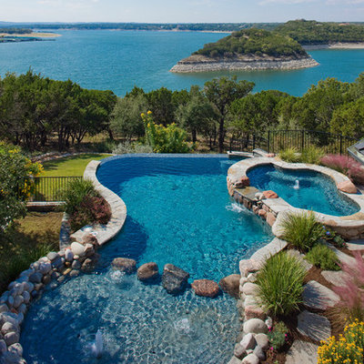 Inspiration for a timeless custom-shaped infinity hot tub remodel in Austin