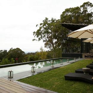 シドニーの中サイズの長方形カントリー風おしゃれなプール (天然石敷き) の写真