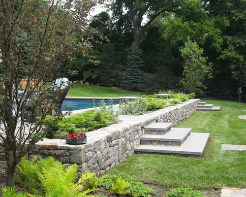 Retaining wall pool home design ideas pictures remodel for Pool design for sloped yard