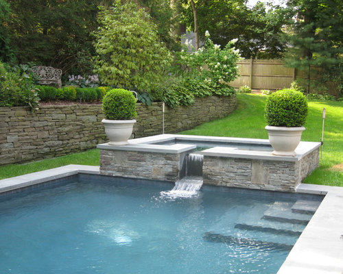 Waterline Pool Tile Ideas slate pool tile maureen gilmer morongo valley ca Example Of A Trendy Pool Design In New York With A Hot Tub