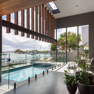 Contemporary rectangular lap pool in Sunshine Coast with concrete slab.