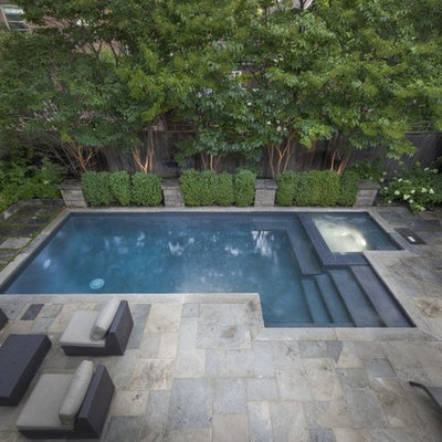 Example of a small trendy backyard stone and rectangular hot tub design in Toronto