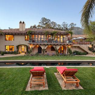 Pool - large mediterranean backyard rectangular lap pool idea in Santa Barbara