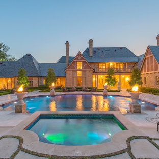 Hot tub - large traditional courtyard custom-shaped hot tub idea in Dallas