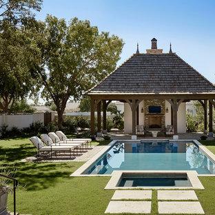 Design ideas for a mediterranean backyard rectangular pool in Phoenix with a hot tub.