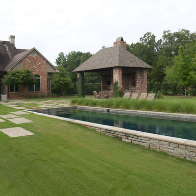 Inspiration for a large contemporary backyard stone and rectangular lap pool house remodel in New Orleans