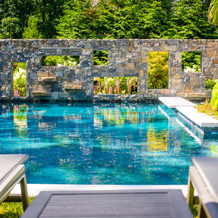 This is an example of a small country backyard l-shaped pool in New York.