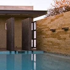 Midcentury Exterior by Laidlaw Schultz architects