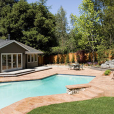 Traditional Pool by Harrell Remodeling