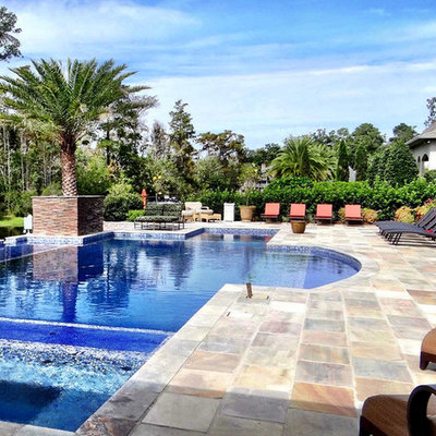Hot tub - mid-sized tropical backyard tile and rectangular lap hot tub idea in New Orleans