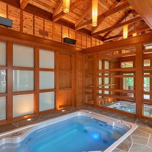 Ejemplo de casa de la piscina y piscina alargada, clásica renovada, grande, interior y rectangular