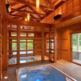 Foto de casa de la piscina y piscina alargada, clásica renovada, grande, interior y rectangular, con adoquines de piedra natural