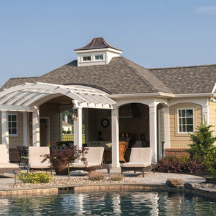 Design ideas for an eclectic pool in Other with a pool house.
