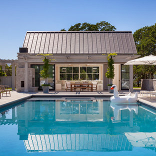 Country rectangular pool in San Francisco with a pool house.
