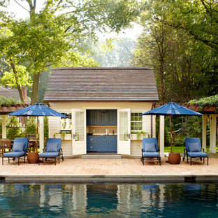 Country pool in New York with brick pavers and a pool house.