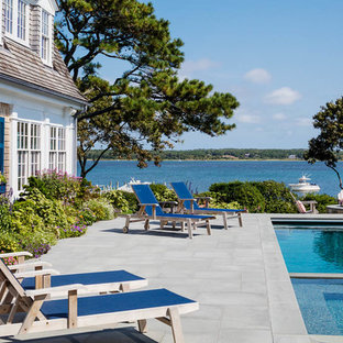 Design ideas for a large beach style side yard rectangular natural pool in Boston with a hot tub and concrete pavers.