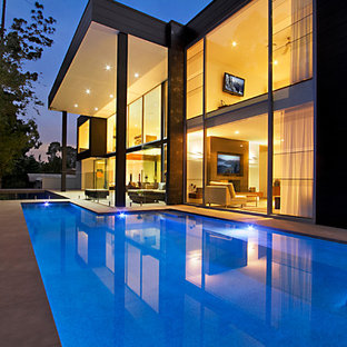 Inspiration for a mid-sized modern backyard concrete paver and l-shaped lap pool remodel in Brisbane