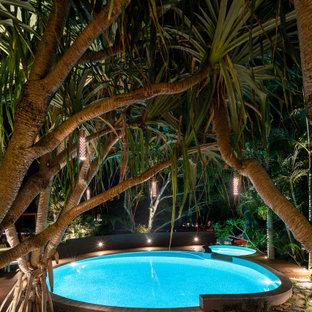 Modelo de piscinas y jacuzzis tropicales redondeados