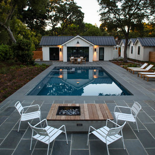 Large cottage backyard rectangular and stone pool house photo in San Francisco