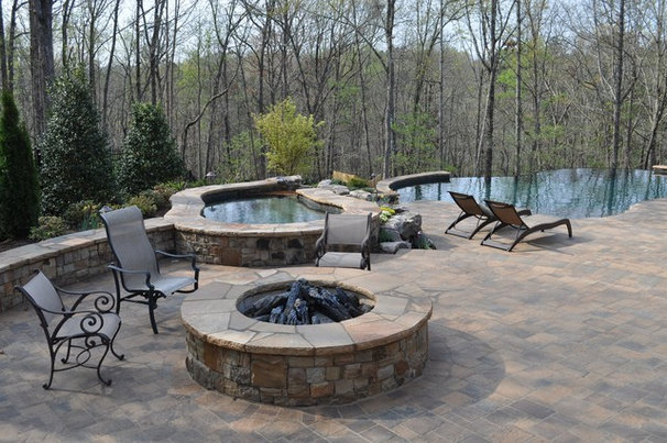 Traditional Pool by PaverStone Construction and Greenmark Landscaping