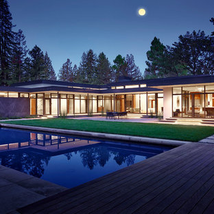 Inspiration for a large contemporary backyard rectangular pool house remodel in Los Angeles