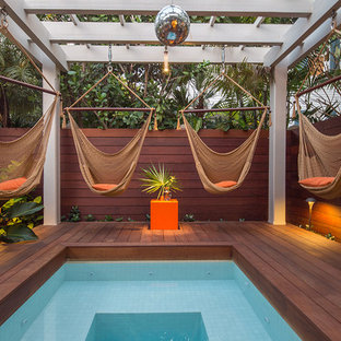 Photo of a small tropical pool in Miami with decking.