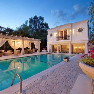 Pool - mediterranean rectangular pool idea in Tampa